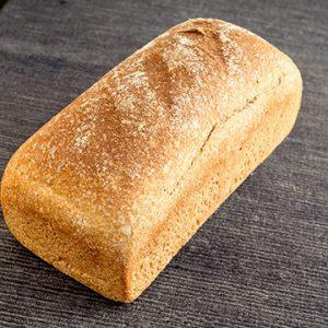Pan de Molde Ecológico de Trigo Integral Pequeño de Fermentación Mixta. Cortado